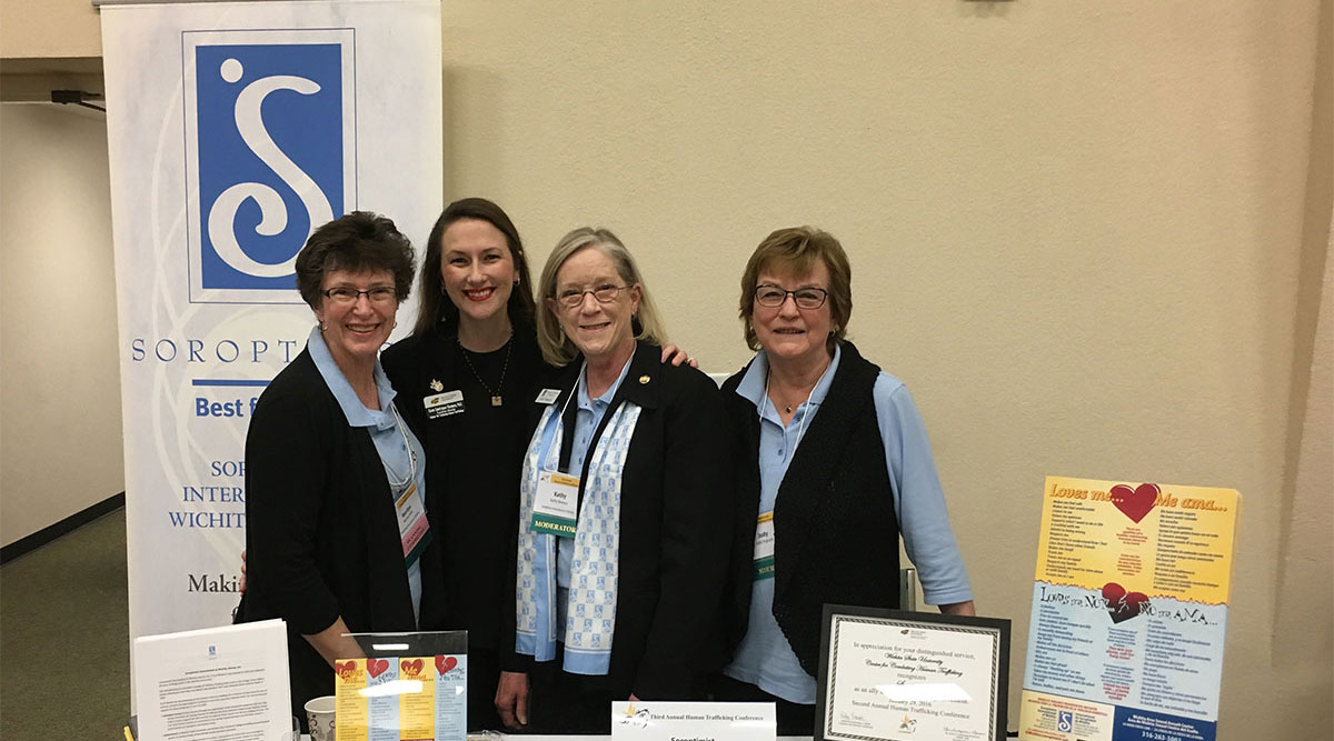 Soroptimist International Wichita - Volunteers with Bookmarks at Human Trafficking Conference